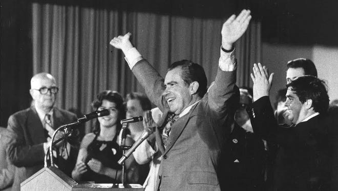 Richard Nixon acknowledges the Hyden crowd's cheering, during his 1978 visit. At the right is county Judge C. Allen Muncy, who invited the former president