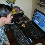 Jon Hernandez chooses from several games of online poker from his home in Roselle Park, N.J., the day after New Jersey began offering Internet gambling statewide in November 2013.