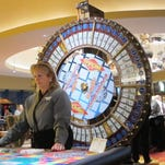 A dealer waits for customers at a cash wheel game at the Tropicana Casino and Resort in Atlantic City in April.