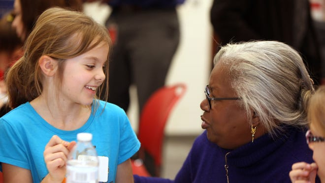 Sharon Robinson helps Sophia Sontag, 10, daughter of Rachel Sontag of Fairfax, write an essay about using good character to overcome obstacles.