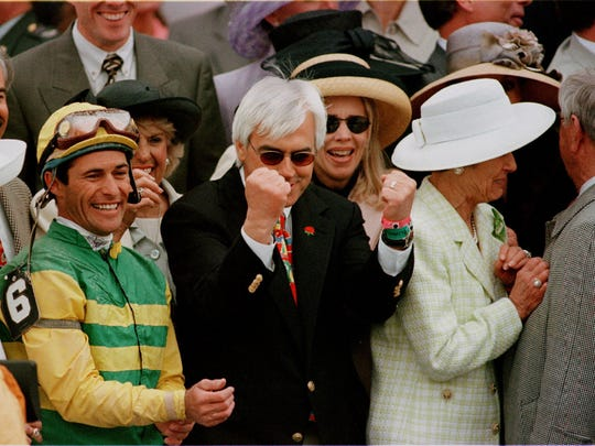 Bob Baffert, trainer of Silver Charm, was all emotion in the winner's circle after the 1997 Kentucky Derby. Beside him was jockey, Gary Stevens. On the other side is Beverly Lewis, a co-owner.