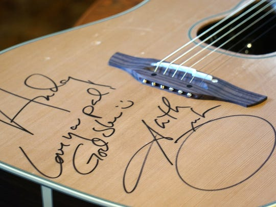 The guitar given to Andy Bushey by Garth Brooks after a concert last week.