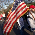 Verizon Fios call center worker Stephen Gruver, Beachwood, marches on a picket line outside the Hamilton, NJ, Call Center as the strike against the company kicks off Wednesday morning, April 13, 2016.