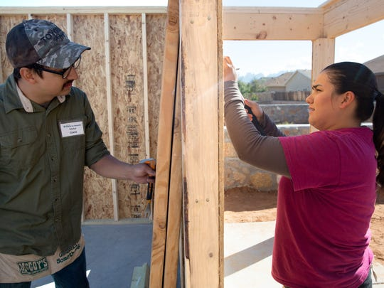 Victor and Delilah Ojeda work on their neighbor Luis Ontiveros's home Friday, November 11, 2016. The Ojedas' received a home from Habitat from Humanity that is also under construction, but both of them said they loved doing the work and had fun building and learning how to build.