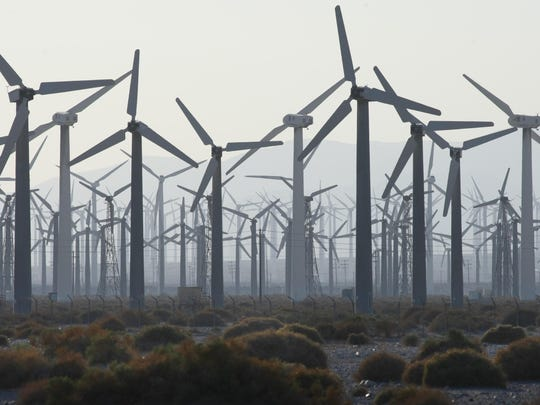 A sea of wind turbines is seen in the fading light from Indian Canyon Road on Aug. 15, 2013.