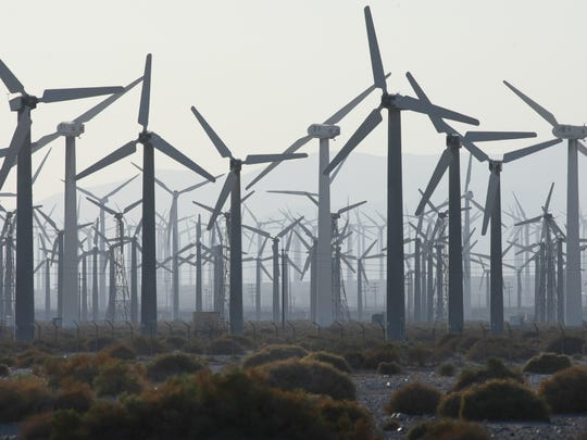 A sea of windmills appears in the fading light on Indian Canyon Road on Aug. 15, 2013.