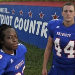 Anthony Johnson Jr., left, and Brice Peaden of the Pace High varsity football squad.