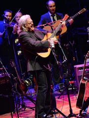 Ricky Skaggs  performs at the CMA Theater in Nashville in 2013.