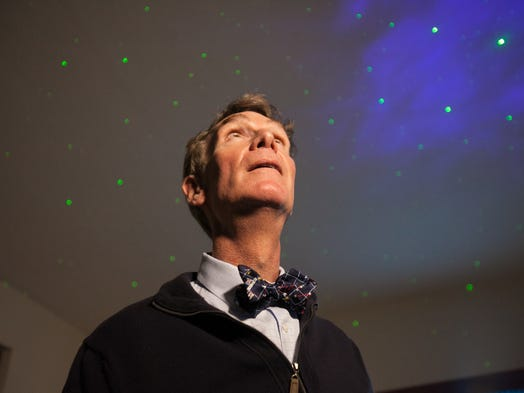 "After each video interview, we photograph the guest for Talking Your Tech. Here's Bill Nye, ""the Science Guy,"" at his home in Los Angeles. When we noticed the stars on his ceiling, we asked him to turn off the lights to shoot him against the artificial space, illuminating him with a Litepanels LED light."