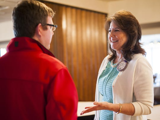 Lacey Gallagher speaks to Scott Reasoner after a Rotary Club meeting at Meadowlark Country Club in February.