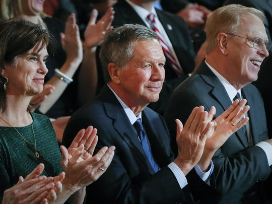 In this Monday, Jan. 14, 2019 photo, former Ohio Gov. John Kasich applauds during a public inauguration ceremony for Gov. Mike DeWine at the Ohio Statehouse, in Columbus, Ohio. Kasich says he's joined CNN as a political commentator. The Ohio Republican is a frequent critic of President Donald Trump and a potential 2020 presidential contender. Kasich announced in a tweet on Tuesday, Jan. 15 he will begin immediately as a regular contributor on the cable news network.