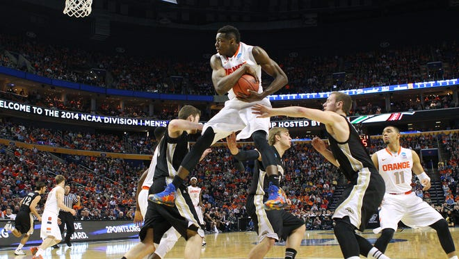 Syracuse's Jerami Grant (3) soars high to pull in a rebound in a 77-53 win over Western Michigan in 2nd round of the NCAA tournament.