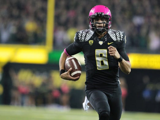 Oregon Ducks quarterback Marcus Mariota completed 23-of-32 passes for 327 yards with two touchdowns, and ran for 67 yards with one touchdown in Week 8.