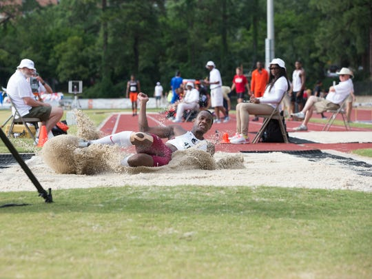 FSU senior Paul Madzivire makes a splash in the sand following a long jump attempt. Madzivire is a three-time ACC champion but has been recovering from a serious neck injury.