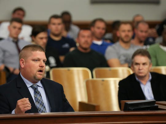 FOP President and LMPD Police Sgt. Dave Mutchler voices his concerns about Louisville Metro Police Chief Steve Conrad's plan to restructure the LMPD.  The LMPD flex platoon patrol which will be disbanded under the plan looks on in the backbround.