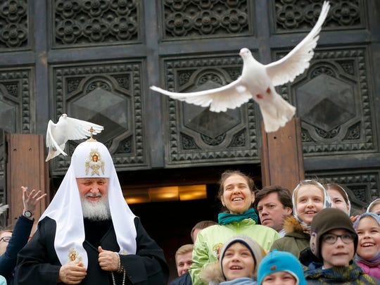 Russian Orthodox Church Patriarch Kirill, center, releases birds celebrating the Annunciation on the eve of Orthodox Easter at the Christ the Savior Cathedral in Moscow. Eastern Orthodox churches, which observe the ancient Julian calendar, usually celebrate Easter later than Western churches.