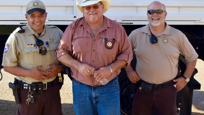 """(L - R) Runnels County deputy Clemente """"Tito"""" Mata, Sheriff Carl Squyres and Chief Deputy Steve Gray participate in National Night Out in 2018. Gray is retiring after almost 46 years in law enforcement."""