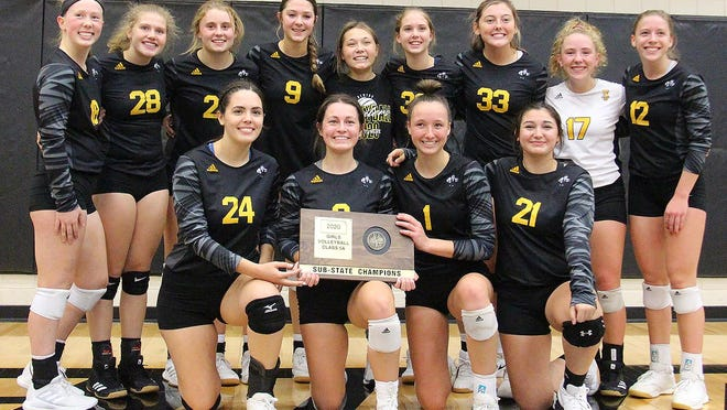 The Newton High School volleyball team celebrates a Class 5A sub-state title Saturday at Andover Central. The Railers beat Central in three sets and Andover in two sets. Newton hosts Bishop Carroll Tuesday in a state quarterfinal match.