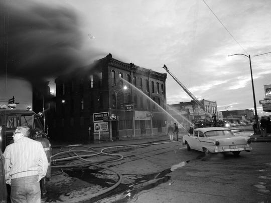 Firemen battle a blaze at the Biggs Hotel, located on the northeast corner of Jefferson Avenue and Commercial Street.
