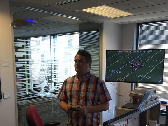 Justin Duke is grateful for a job that allows him to play with producer Bob Strickley's Millennium Falcon drone and the office copy of Madden NFL.