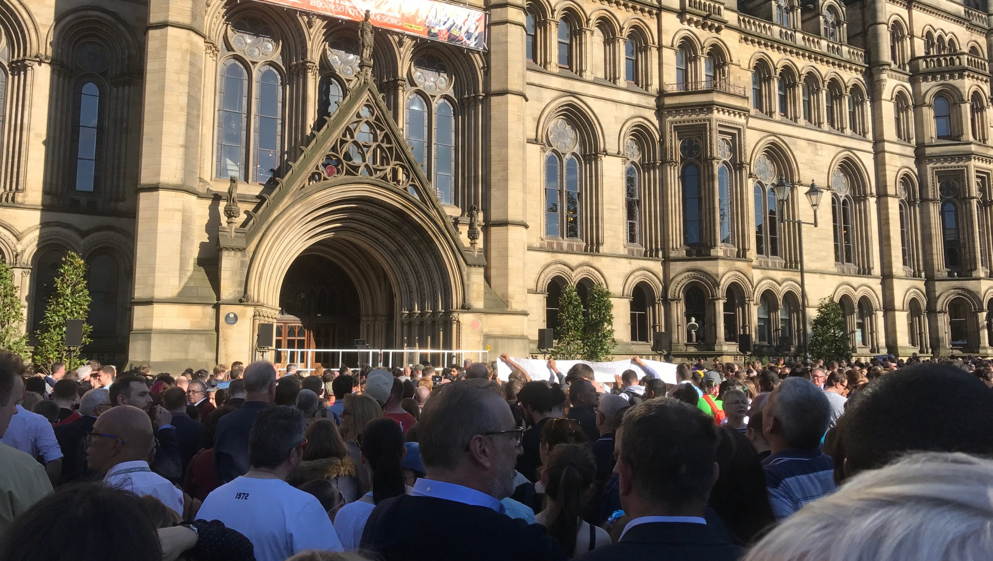Manchester Over e but defiant at vigil