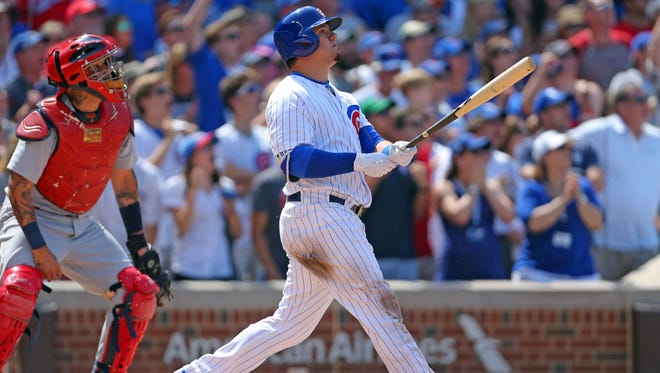 Chicago Cubs left fielder Kyle Schwarber (12) hits a grand slam home run during the seventh inning against the St. Louis Cardinals at Wrigley Field on June 3.