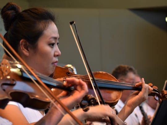 The violin section for the San Angelo Symphony Orchestra plays during the 2018 Pops Concert.