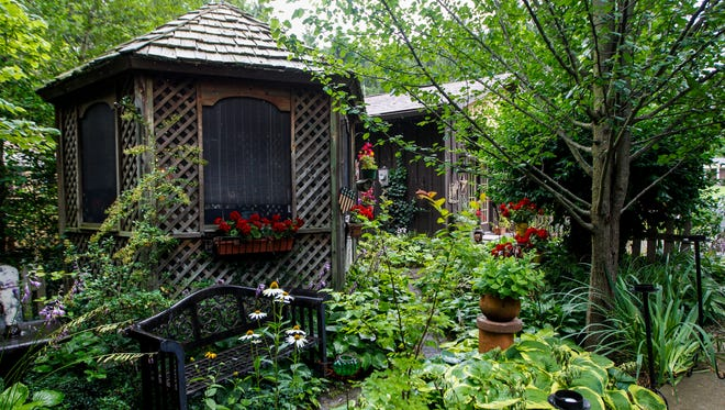 A gazebo sits in the garden at the home of Margie and Bill Ellis Tuesday, July 11, 2017 in Georgetown.