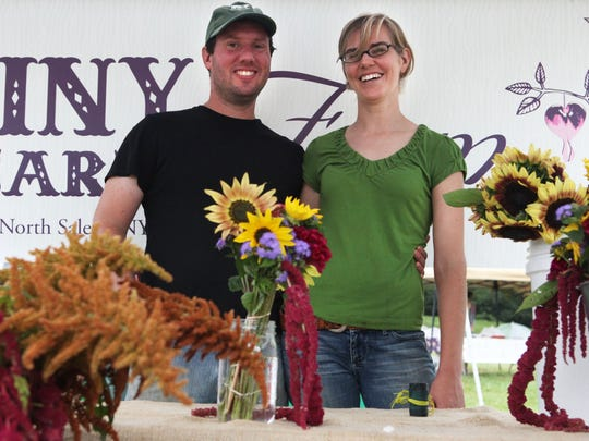 Luke Franco and Jennifer Elliott of Tiny Hearts Farm of North Salem are photographed at the John Jay Homestead Farmers Market in Katonah in 2012.