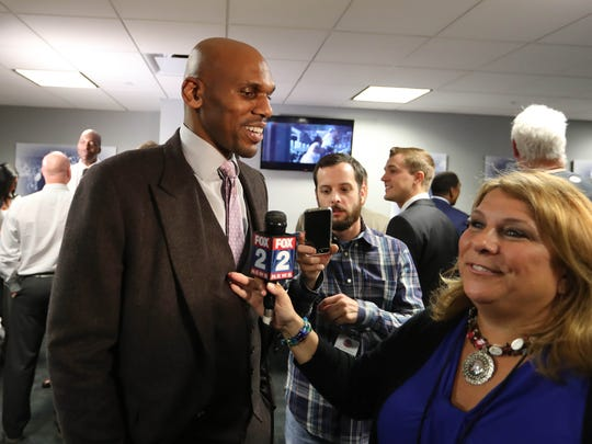 Former Pistons guard Jerry Stackhouse talks with reporters