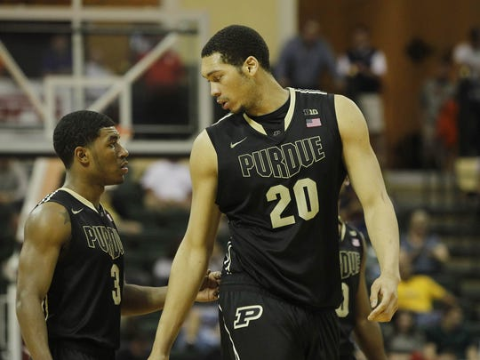 Purdue's A.J. Hammons (20) and  Ronnie Johnson (3).