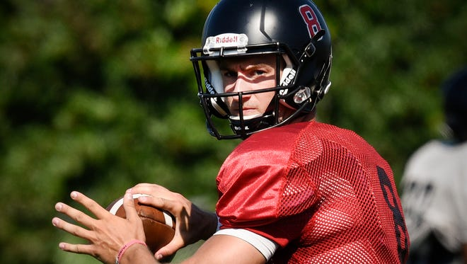 St. Cloud State Quarterback Nate Meyer drops back and looks for a receiver during practice Monday, Aug. 22, 2016, at Husky Field.