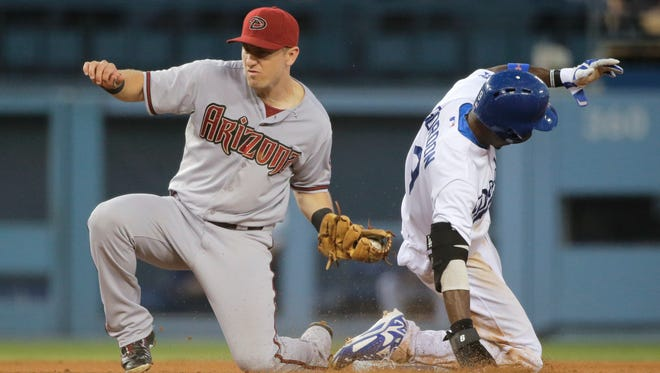 The Los Angeles Dodgers' Dee Gordon, right, is caught stealing second base by Arizona Diamondbacks shortstop Cliff Pennington on Sept. 6, 2014, in Los Angeles.