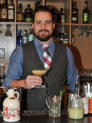 "Jason Foust shows off his cocktail, ""Hoosier Heritage."" He is a finalist for the Indiana State Museum's 2015 Cocktail Contest."