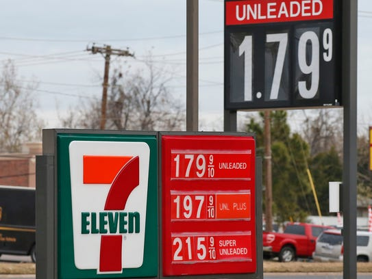 Gas prices are shown on a sign at a 7-11 in Oklahoma