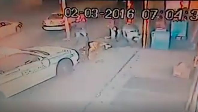 A screenshot taken from video footage that shows a Rochester cop car plowing into a man on the sidewalk.