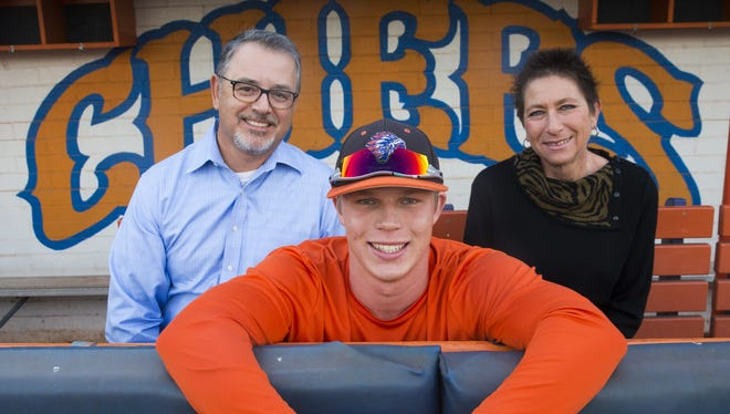 Thunderbird High pitcher Sasha Sneider with his parents David and Cheryl November 21, 2016. Sasha was adopted from Russia when he was almost two years old.