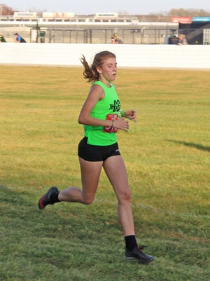 Coldwater's Legend Szafranski powers her way to the finish at Friday's MHSAA State Finals.