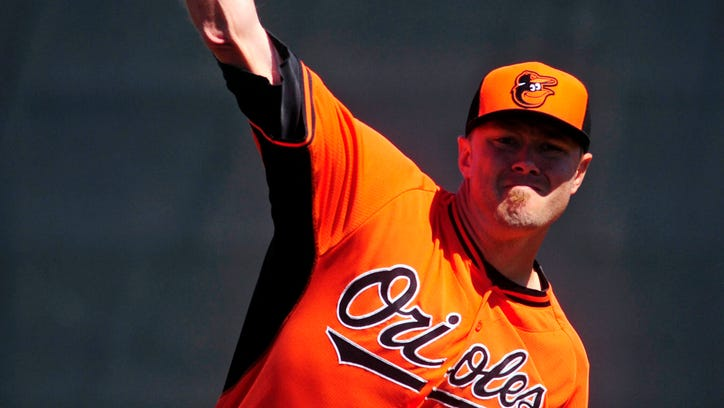 Feb 28, 2014; Port Charlotte, FL, USA; Baltimore Orioles starting pitcher Chris Tillman warms up in the first inning against the Tampa Bay Rays in a spring training exhibition game at Charlotte Sports Park. Mandatory Credit: David Manning-USA TODAY Sports