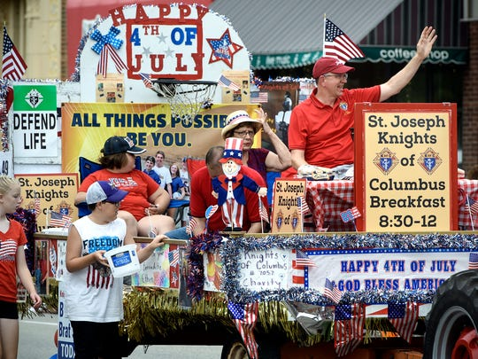 People wave from the St. Joseph Knights of Columbus float Wednesday during the St. Joseph Lions 2018 Fourth of July Parade.