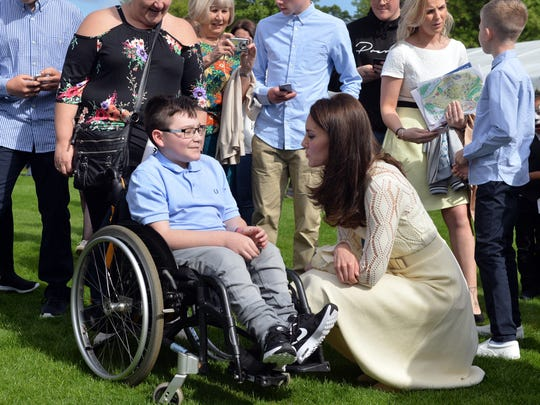 Duchess Kate talks with one of the children during