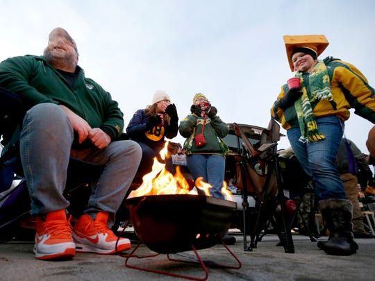 Green Bay Packers fans tailgate before the Jan. 3, 2016, game against the Minnesota Vikings at Lambeau Field in Green Bay.