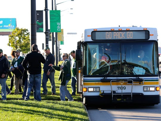 A Green Bay Metro Transit bus drops off fans along