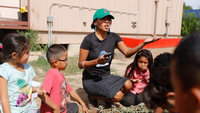 Teacher Celeste Yazzie talks to her students on Wednesday at Dream Diné Charter School in Shiprock.