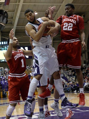 Feb 25, 2015; Evanston, IL, USA; Northwestern Wildcats guard/forward Sanjay Lumpkin (34) grabs a rebound in front of Indiana Hoosiers guard James Blackmon Jr. (1) and guard Stanford Robinson (22)  during the first half at Welsh-Ryan Arena. Mandatory Credit: David Banks-USA TODAY Sports