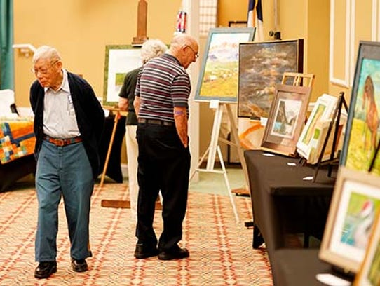 Residents of Indian River Estates browse the inaugural Arts