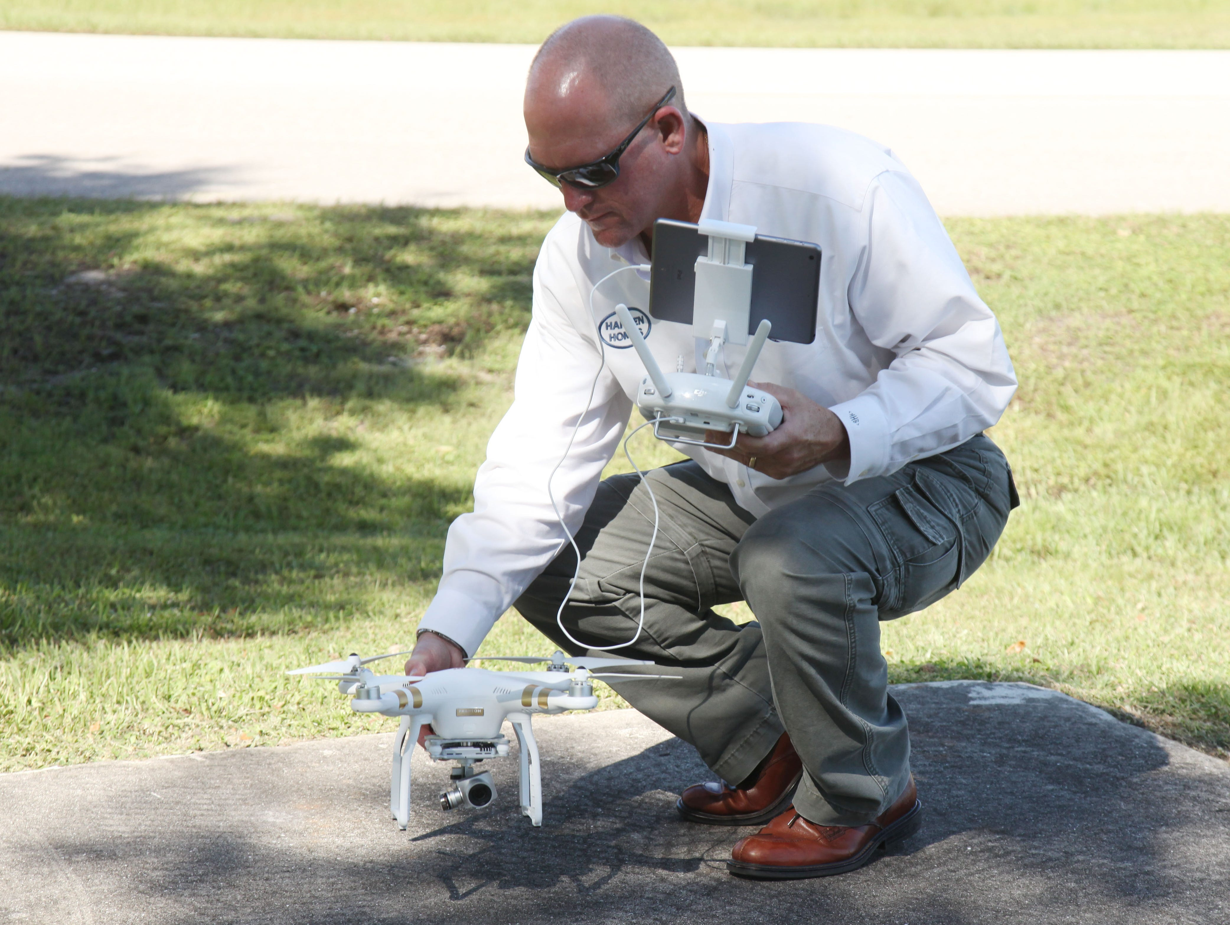 Mark Harden lands a DJI Pantom 3 Professional drone that he uses to record football games for Southwest Florida Christian Academy.