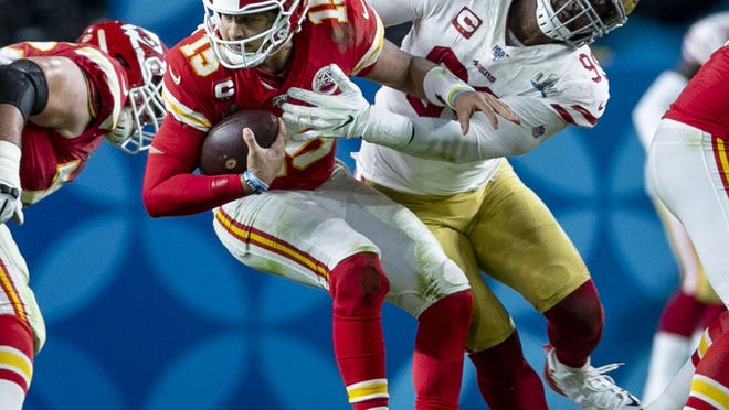 Kansas City's #15 Patrick Mahomes is sacked by San Francisco's #99 DeForest Buckner during the second half of Super Bowl LIV at Hard Rock Stadium in Miami Gardens, Feb. 2, 2020.