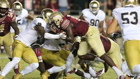 Florida State's Karlos Williams runs for a touchdown against Notre Dame during the third quarter of an NCAA college football game, Saturday, Oct. 18, 2014 in Tallahassee, Fla. Florida State won 31-27.