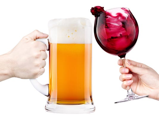 Stein of beer and glass of red wine